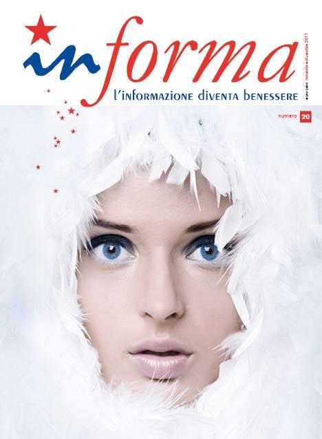 La copertina rappresenta un volto di donna in primo piano con gli occhi azzurri e trucco leggero con colori chiari che compare da una parete di piume